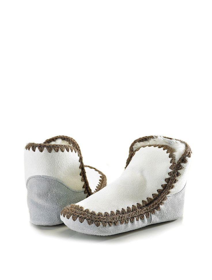 Snuggle Feet, a Classic Sheepskins speciality, NZ made ensuring quality and warmth, the ultimate indoor slipper.   (http://www.classicsheepskins.com/snuggle-feet/)