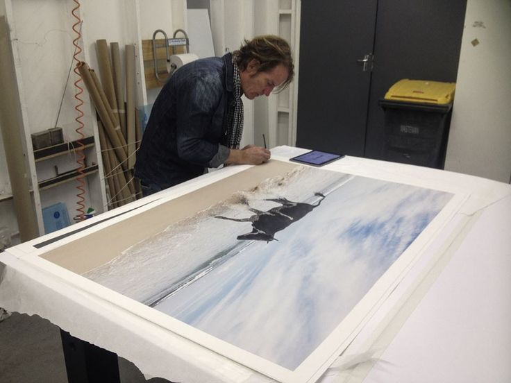 Here you get a glimpse of the scale of some of the Amapondo works as Christopher Rimmer signs away. Each work is immaculately clear and crisp even in its largest size. #photography #printing #artist #melbourne #southafrica #australianart #studio