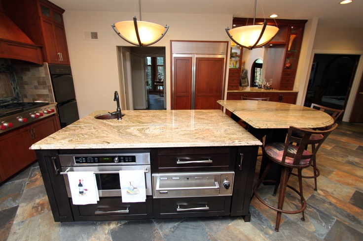 Rustic Craftsman Cherry Kitchen with Contrasting Espresso Island in Bel Air, MD.  Island with a built in microwave and a warming drawer