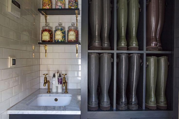 Bespoke boot storage and Aged Brass taps by deVOL.  Interior Designer: Imraan Ismail Interiors  Photographer: Daniella Cesarei