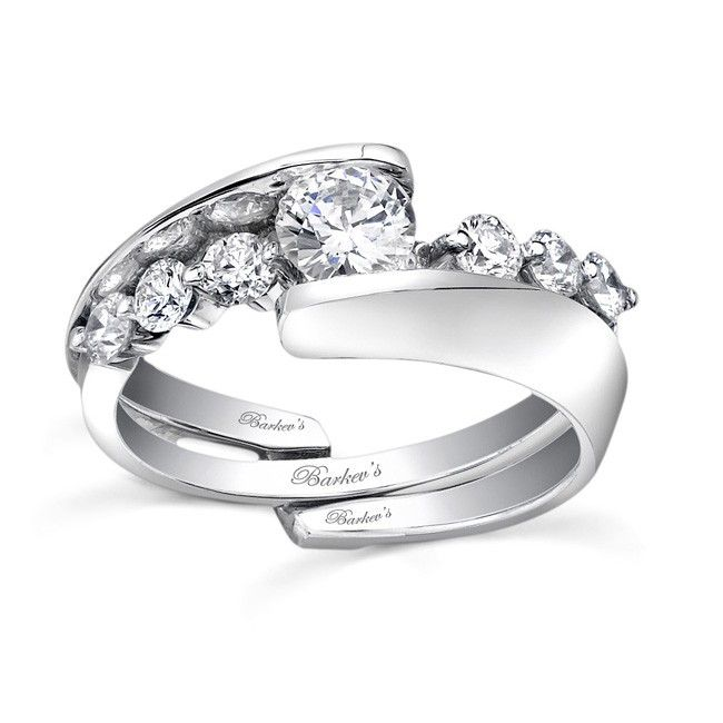 This unique diamond wedding ring set features an interlocking engagement ring and wedding band.