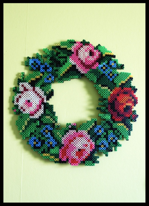 Flower wreath made with hama beads.