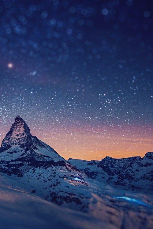 Starry Mountains over Mount Matterhorn, Swiss Alps.