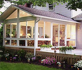 sunroom opening onto the deck. sunroom must face the sun for most of the day =]