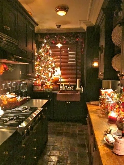 Cozy Christmas Kitchen. Interesting that the sink is separate from the rest of the counter space.