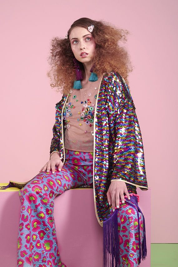 New amazing rainbow sparkle kimono by L.O.M • Stunning rainbow holographic sequins • Purple fringing • Rainbow pom pom trim • Lightweight mesh base • Gold Lamé trim • Beautiful drape • Perfect cover up at festivals, beach or pool party • Looks great worn with our lycra pieces, or a simple black dress • One Size • Made in England