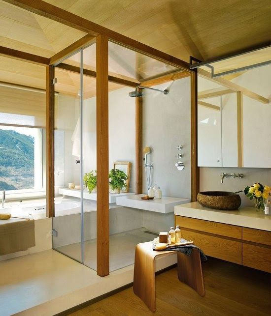 Zen Bathroom. Love the natural materials. the sink looks like it was carved out out rock, love the glass & the view.