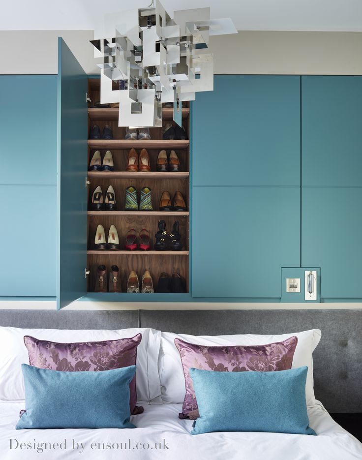 Master bedroom with bright teal shoe cupboards and colour matched cushions. A great place for the Jimmy Choos!