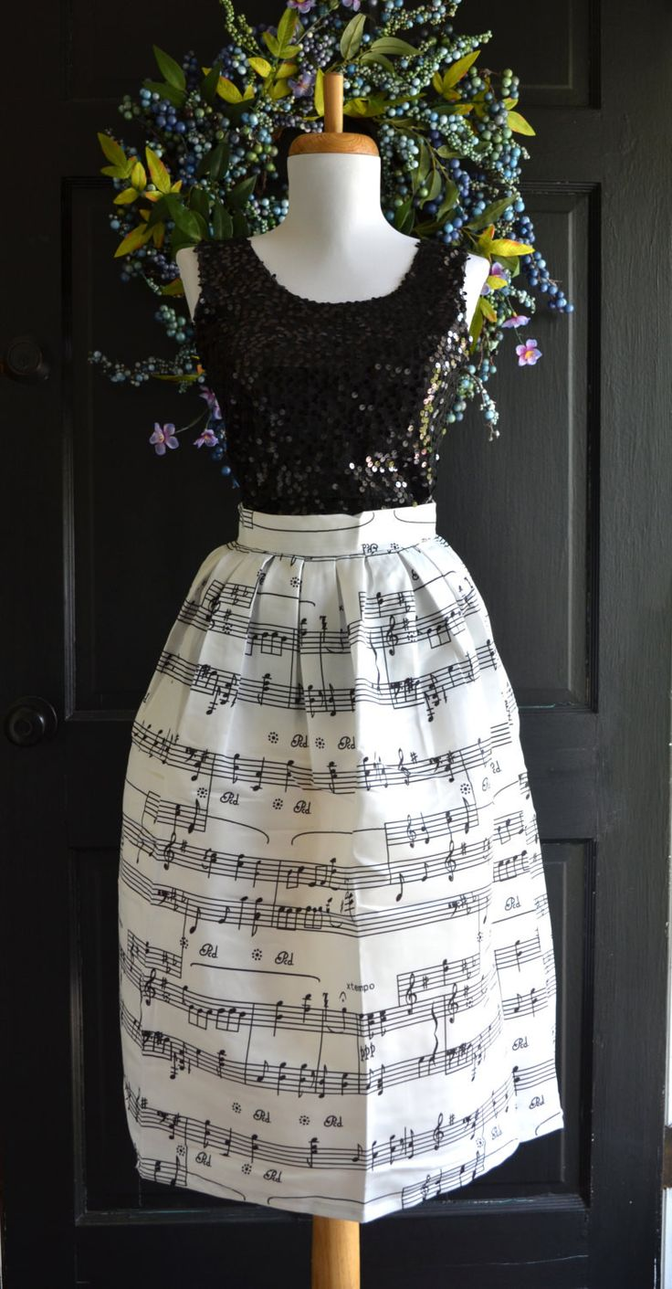 I found this fabulous fabric and could not pass it up. I made this beautiful dirndl style skirt w/ size zip and wide waistband. This would be perfect for anyone in the music field, a special concert,