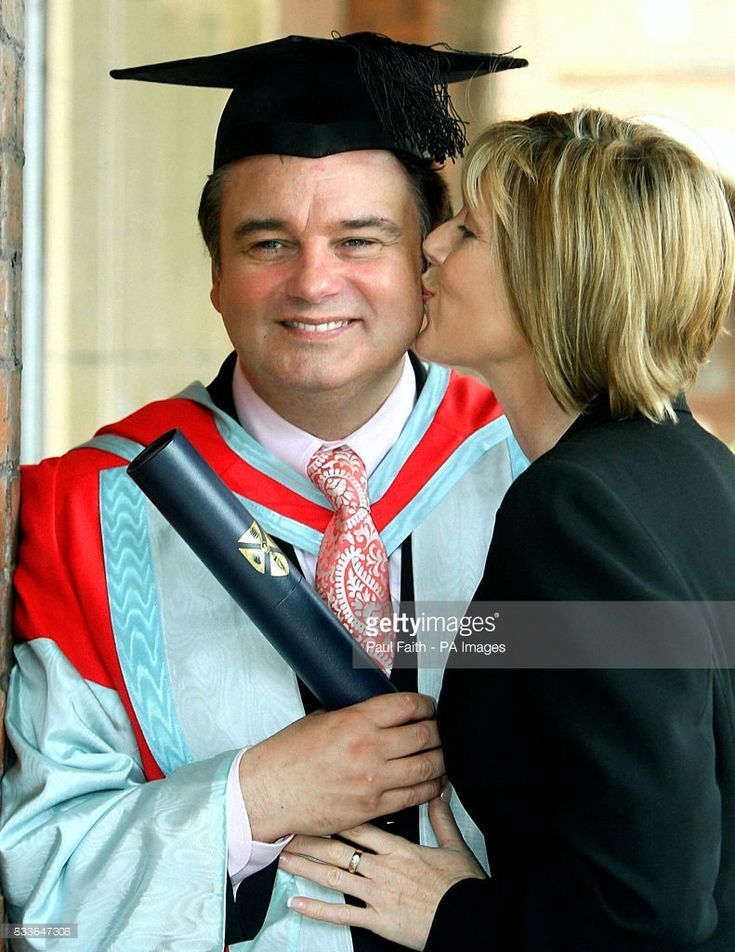 TV presenter Eamonn Holmes is kissed by partner Ruth Langsford, during a photocall at Queens University, Belfast, after he was awarded an honouary Doctorate of the University for services to broadcasting.