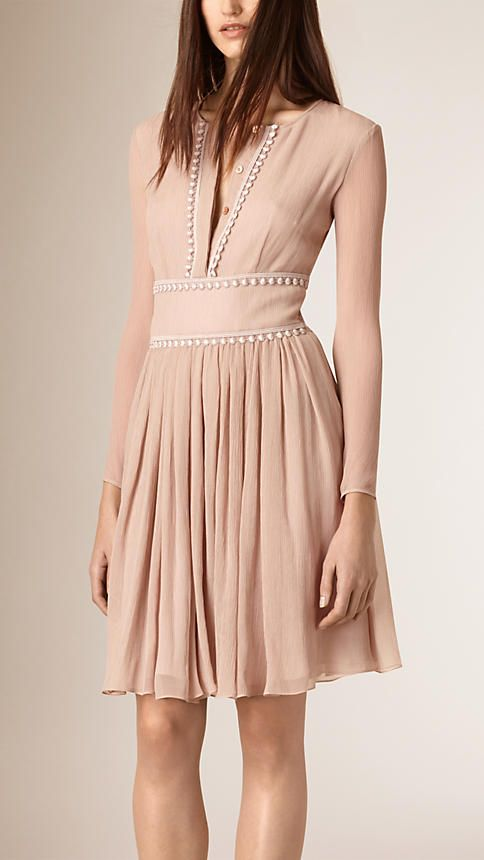 Burberry Italian-made dress in textured crepe silk with a beaded lace trim. The long-sleeved design is cut with a defined waist and gathered skirt. The body is lined in silk, leaving the arms sheer. Discover the women's dress collection at Burberry.com