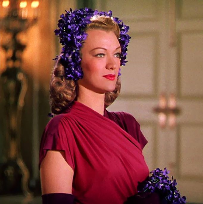 "Eve Arden in ""Cover Girl"" 40s vintage fashion style purple hat hair piece red rayon dress floral movie star still photo color"