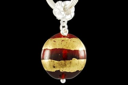red glass, flat round shape, with 24k gold foil. Diameter mm. 20.