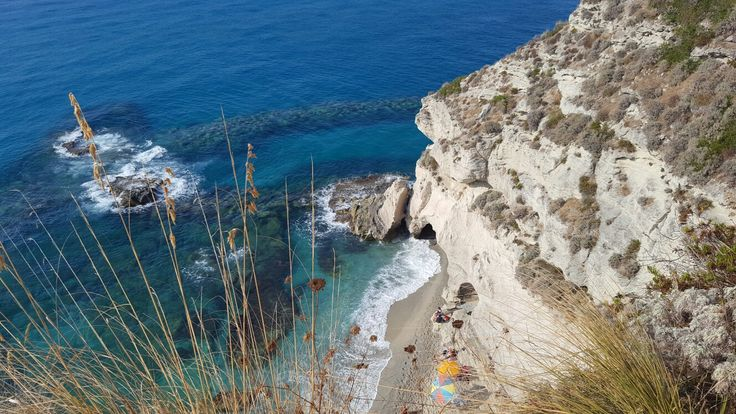 Discovering Tropea, Italy. View of the grote from the stone church.
