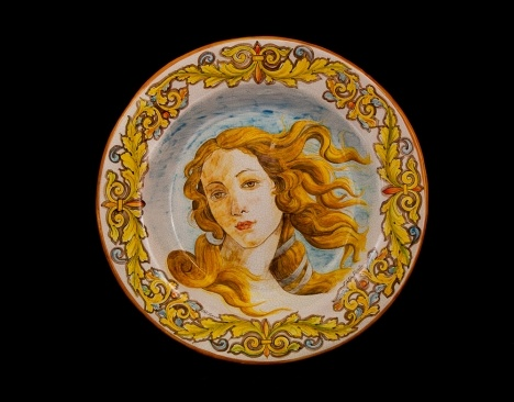 """Pottery!Pottery!Pottery!  This plate is made by hand according to the ancient tradition from the town of Santo Stefano di Camastra. The decoration, also done entirely by hand on crackle glaze reproduces, in the middle, a detail of the painting """"Birth of Venus"""" by Sandro Botticelli. On the flap, there is a Baroque frame of leaves with brown and orange trailing edge"""