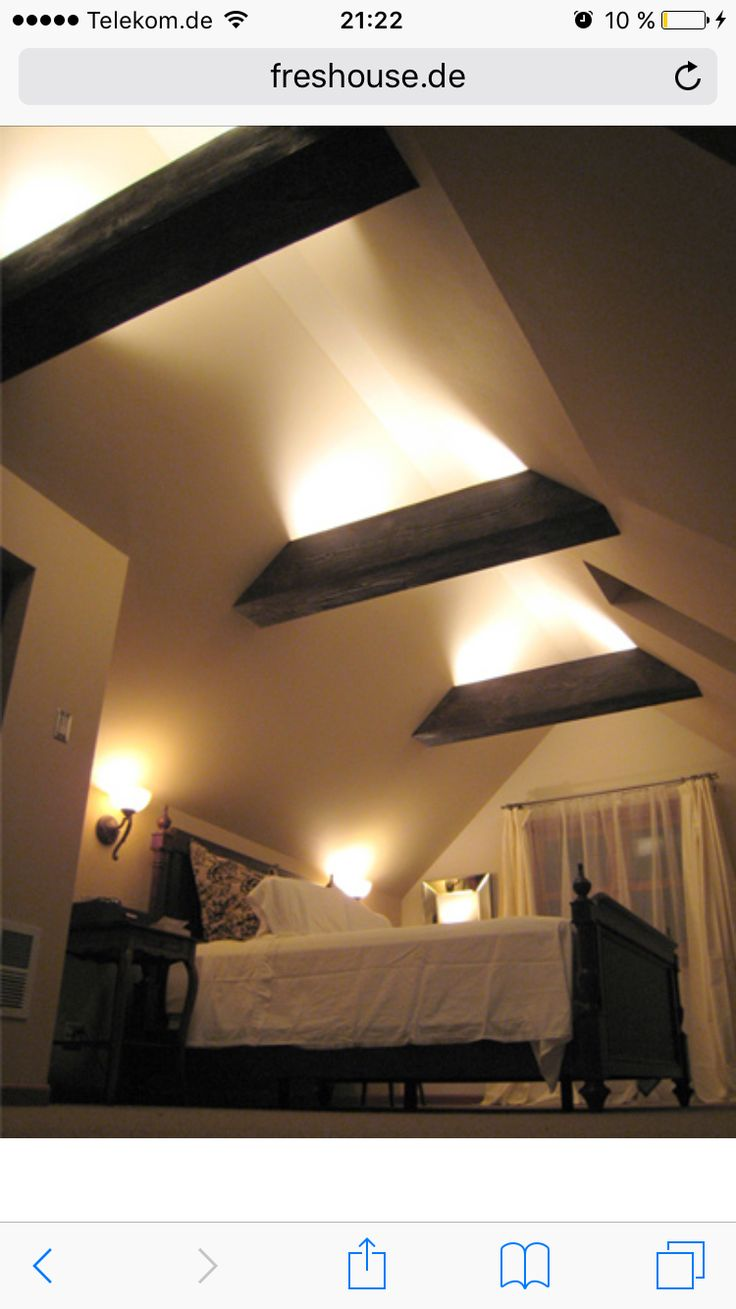 The exposed rafter beams mean greater ceiling height- and they look cool. Could drop a light fixture between beams rather than have the beams lit.