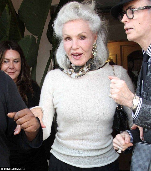 Julie Newmar - bowing to the original  cat woman, 80 years old and her surgeon, she looks incredible.
