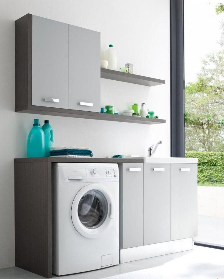 des armoires grises et une machine à laver blanche