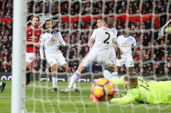 Daley Blind of Manchester United scores their first goal during the Premier League match between Manchester United and Sunderland at Old Trafford on...