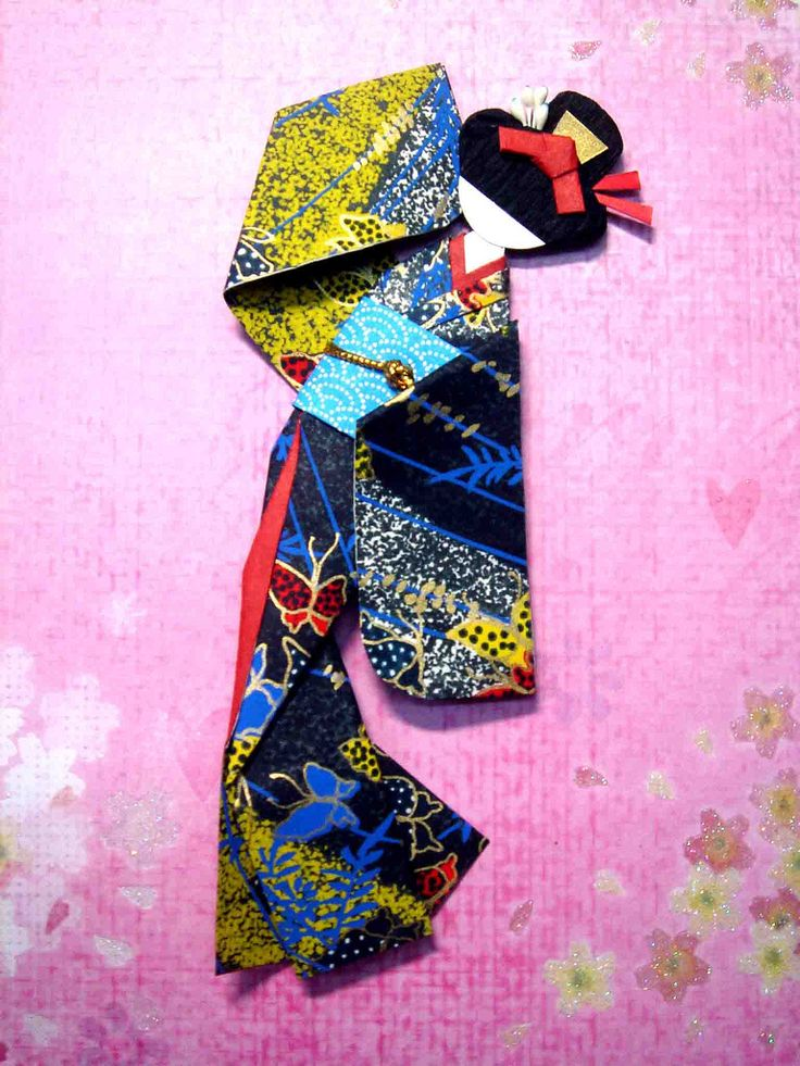 Hand-made Japanese paper doll on pink sakura background_closeup (Given away)
