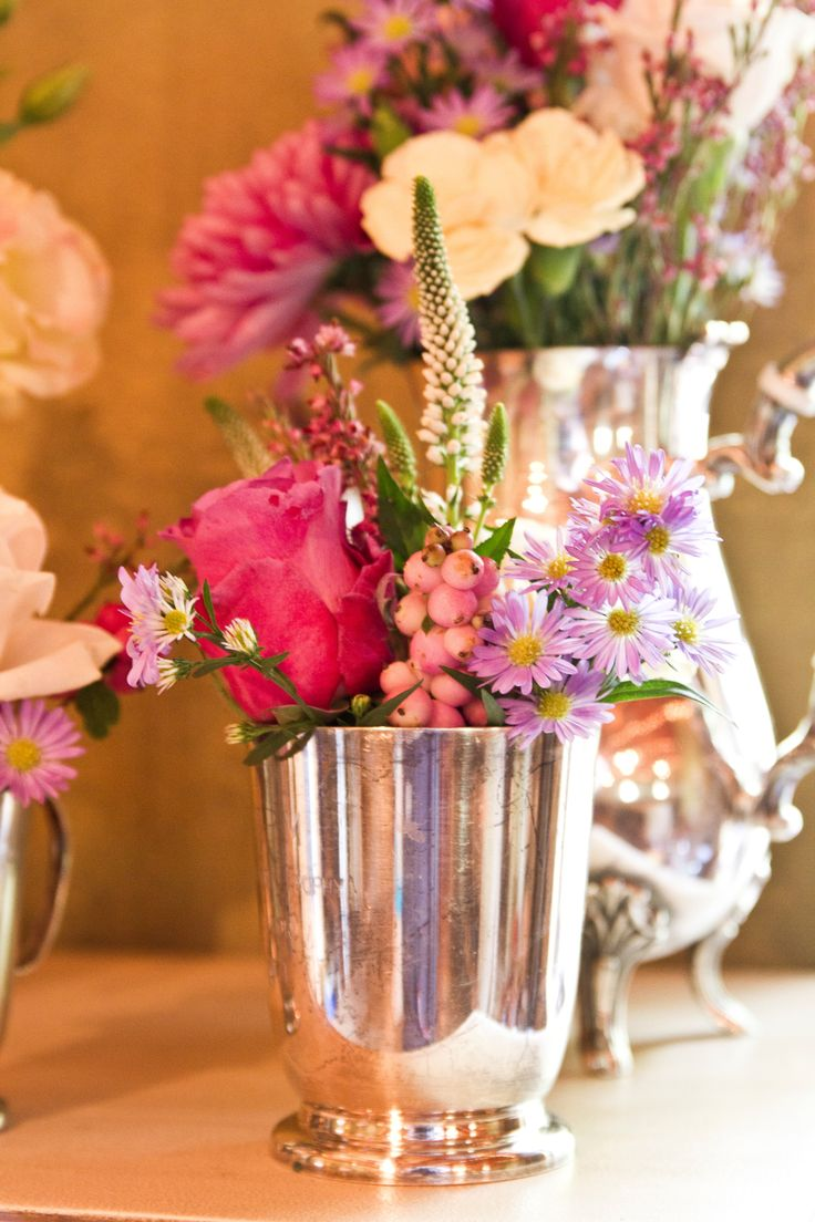 Lovely color flower arrangement in silverware for a wedding.