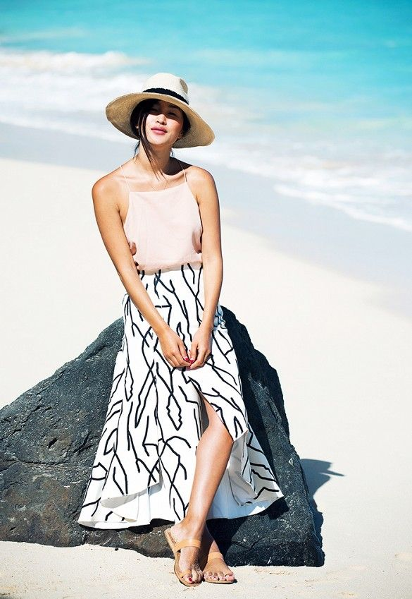 Nicole Warne of Gary Pepper Girl wears a camisole, printed midi skirt, and a fedora