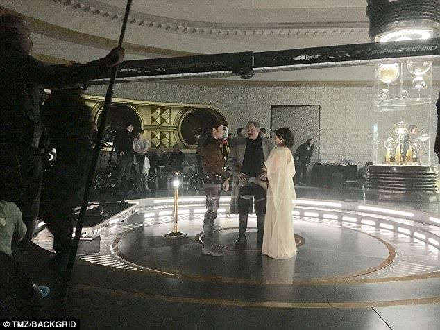 This picture from the set of the movie show Woody Harrelson's character, Beckett, standing with Han Solo - played by Alden Ehrenreich - and a female character - believed to be Game of Thrones starEmilia Clarke