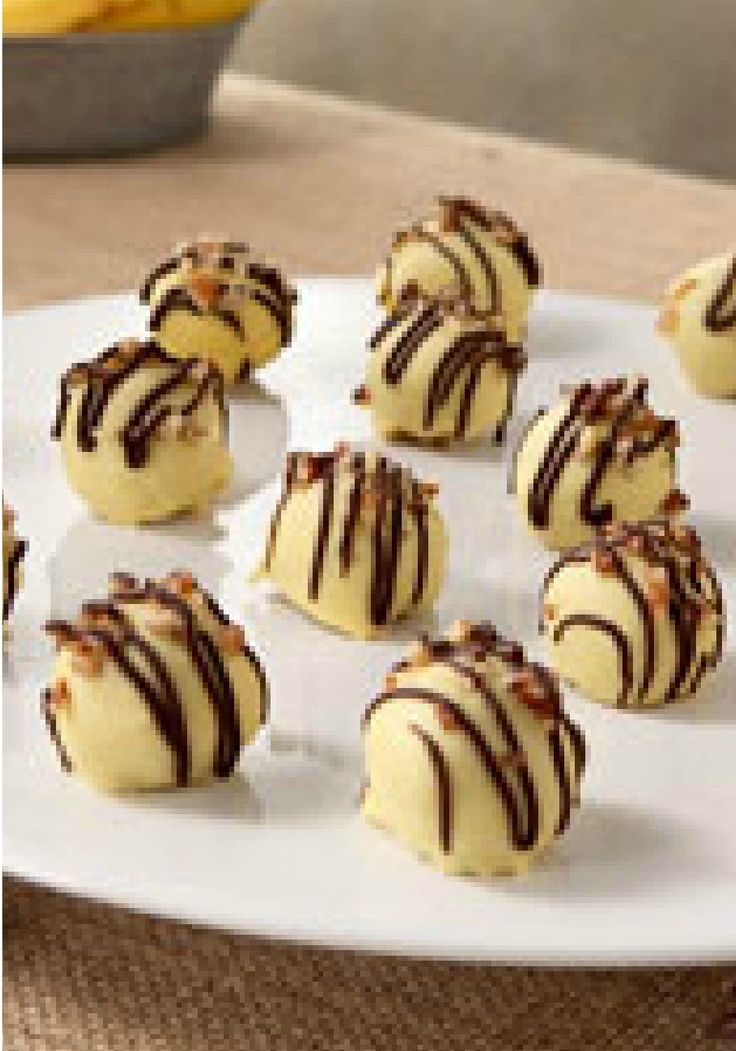 Banana Cookie Balls – Crush vanilla wafers, mix in bananas, encase in white chocolate and ta-da! You've got delicious Banana Cookie Balls that are sure to disappear quickly from the dessert table.