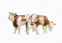 2 vaches avec veau bruns