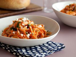 Fettuccine with Creamy Red Pepper Sauce : Jarred roasted red peppers, packed with flavor, make this weeknight pasta dish come together in a flash. Tangy feta is crumbled atop the whole-wheat noodles.