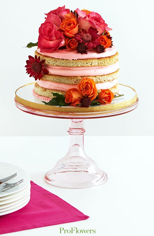 Add fresh flowers to a naked cake to add romance, touches of elegance, pops of color, playful wisps and natural elements.