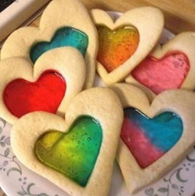 i've always wanted to make cookies like this,but never got around to it yet. heart shaped. rainbow.   RP » Stained Glass Sugar Cookies