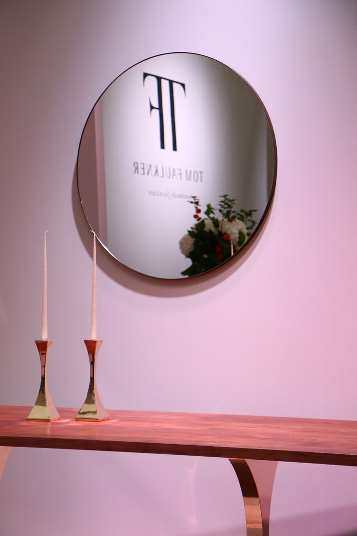 The Lexington circular #mirror above the Paris dining table with Capricorn #candlesticks in polished #bronze.