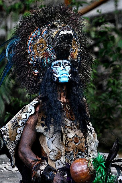Shaman:  Elaborate headdress and rattle.