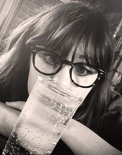 """""""There's potentially a story in everything."""" """"...Even a glass of water?"""" """"Well...potentially."""" Zooey Deschanel. Quirky and great!"""