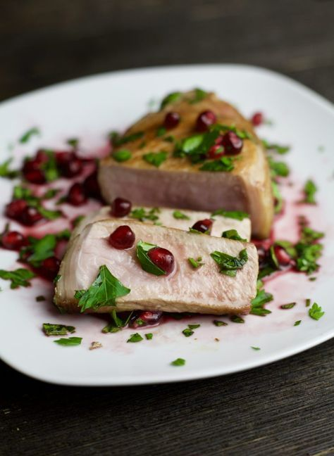 sliced grilled pork chops topped with pomegranate sauce