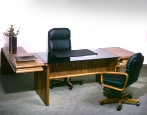 The photo shows the following models in walnut: 8431G/8432/8433/8430 desk w/return 8497W high back executive chair w/black leather 8496W visitor chair w/black leather