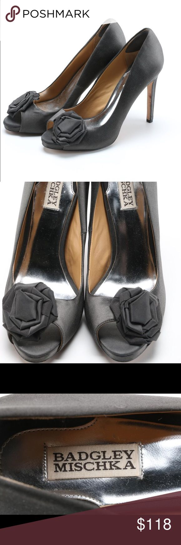 """Badgley Mischka Grey Pumps A pair of women's Badgley Mischka grey pumps. These open-toed shoes feature a black fabric with floral-style bows to the crowns; they have tan lining and silver tone insoles marked """"Badgley Mischka."""" The leather soles contain the maker's label and the shoe size """"9 1/2 M."""" Badgley Mischka Shoes Heels"""