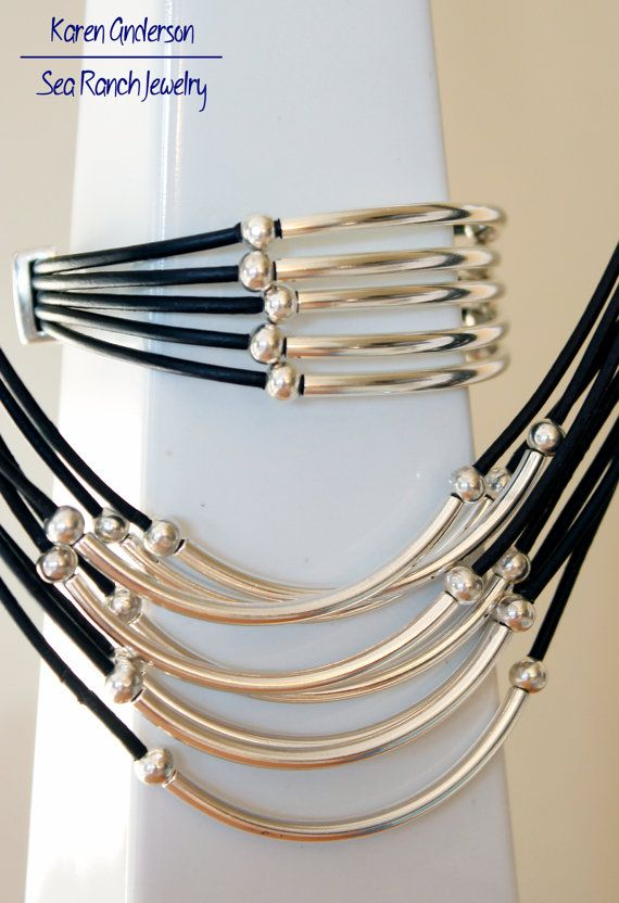 Leather cords and simple silver tubes and beads highlight this set of earrings, necklace and bracelet. In your choice of 4 leather colors. Casual