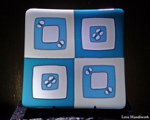 "This is a two tone turquoise green and vanilla cream (approximately 8""x8""x1"" high) square fused glass serving plate. (It appears more blue than turquoise on my screen.) This piece shows how glasses wi"