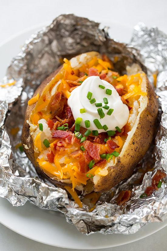 Have you ever tried cooking baked potatoes in a slow cooker? It's really easy and you end up with extremely moist potatoes. All that's left to do is garnish them with your favorite toppings. Broccoli cheese sauce, anyone?!