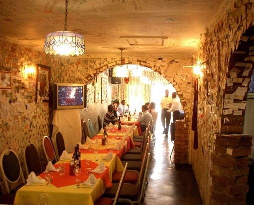 Best Restaurant in Soweto, 'Wandies Place'. The tags on the walls are notes from everyone who has ever dined there. Amazing traditional South African cuisine, friendly locals, and a safe haven for tourists in deep Soweto.
