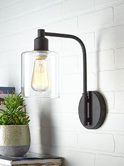 We're seeing a lot of rustic styles, exposed bulbs and mid-century inspirations in lighting right now. Try the CANVAS Arwen Wall Sconce Light!