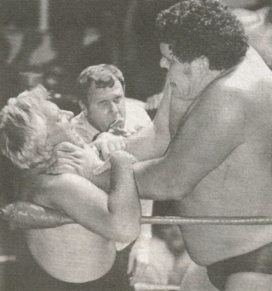 ** Andre the Giant choking Bobby the Brain Heenan