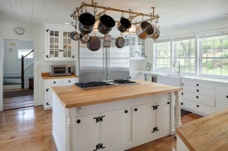 Renee Zellweger's Connecticut Farmhouse. A trio of windows allows for ample sunlight to fill the roomy kitchen.