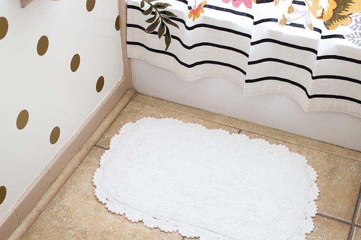 Cute bath mat and polka dot walls