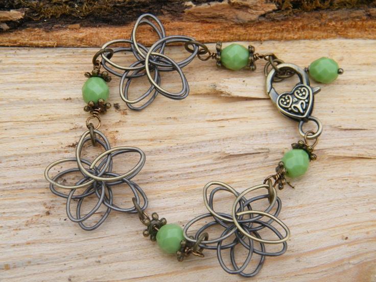 flower bracelet in antique brass.