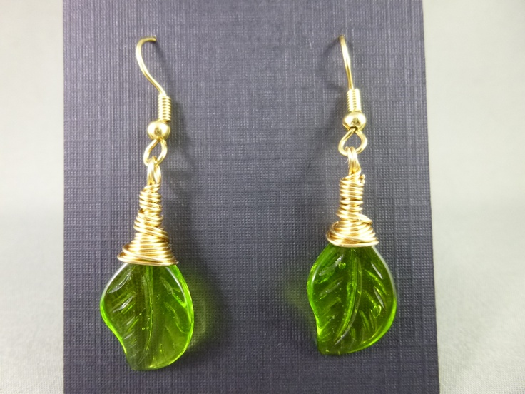 Glass leaves wrapped with a gold tone wire and finished with plated surgical steel earwires.