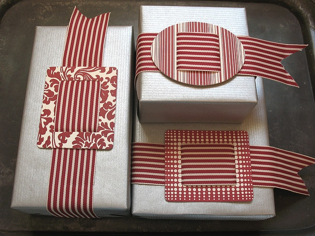 Large paper buckles on packages - with wide striped ribbons - striking!