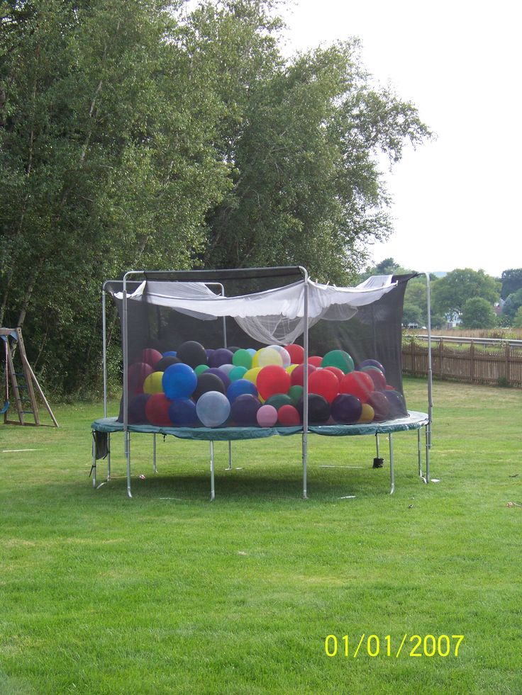 Fill your trampoline with balloons for something alittle different and tons of fun for the young and old.  We made it a game and placed a number on 6 balloons and had the kids enter, one by one,  to try and find their number.   3 Things:  find large balloons, use an air compressor, and make sure you cover the top of the tramoline with something (you may have fly away balloons, if not :)) We used a mosquito net..Enjoy....